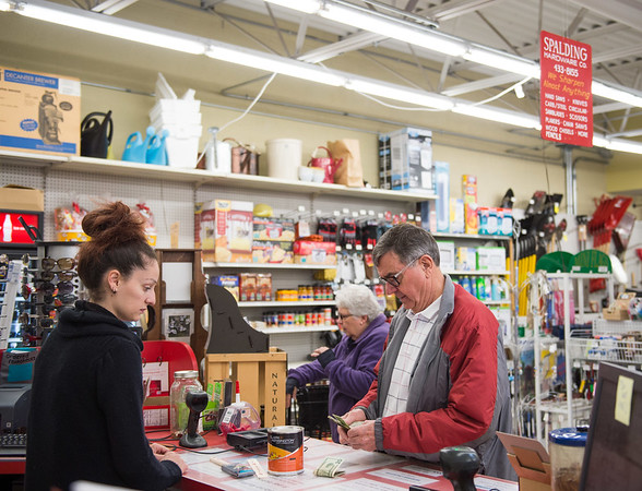 JOED VIERA/STAFF PHOTOGRAPHER-Lockport, NY-Fred Roggow purchase paint for a woodwork project from Cora Santy at the Spalding Ace Hardware store.