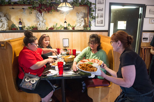 JOED VIERA/STAFF PHOTOGRAPHER-Lockport, NY- Samantha Roman, Maria Roman and Nancy Baes are served dinner by Sue Brown at Molinaro's Restaurant.