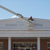 JOED VIERA/STAFF PHOTOGRAPHER-Lockport, NY-A county worker paints  the County Office Building.