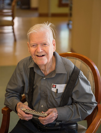 JOED VIERA/STAFF PHOTOGRAPHER-Lockport, NY-Roy Youngstrom, 94, holds his Hohner Chromonica at Lockport Presbyterian Home. Youngstrom recently picked the instrument back up after a 69 year hiatus.