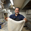 JOED VIERA/STAFF PHOTOGRAPHER-Lockport, NY-Mike Molinaro makes a pizza at Molinaro's Restaurant.