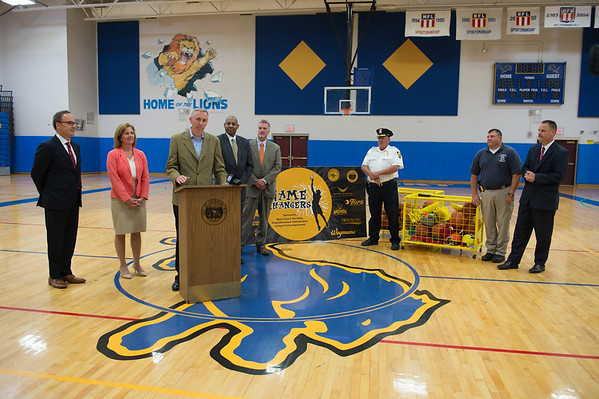 JOED VIERA/STAFF PHOTOGRAPHER-Lockport, NY-Daemen College Head Basketball Coach Mike MacDonald speaks at a press conference for the game changers basketball program.