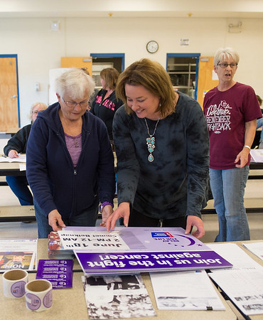 JOED VIERA/STAFF PHOTOGRAPHER-Lockport, NY- Nancy Middaugh and Roberta Callaghan assemble signs promoting Lockport's Relay for Life.