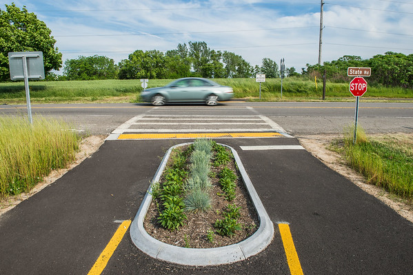 JOED VIERA/STAFF PHOTOGRAPHER-Lockport, NY- A car drives over the State Street crosswalk on the Canal Bike Trail.