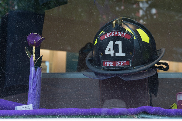 JOED VIERA/STAFF PHOTOGRAPHER-Lockport, NY- A display honors Lockport's Fire Department and promotes the Relay for life in Scirto's Jewelers' front window.