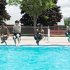 JOED VIERA/STAFF PHOTOGRAPHER-Lockport, NY-Imario Douglass 14, Julian foster 15, Shyreef Payne 15 and Isiah Foster 13 canonball into the Lockport Community Pool.