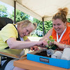 JOED VIERA/STAFF PHOTOGRAPHER-Barker, NY-  Valerie White and Bethany Kader plant a flower into a cup during Camp Happiness at Camp Kenan.