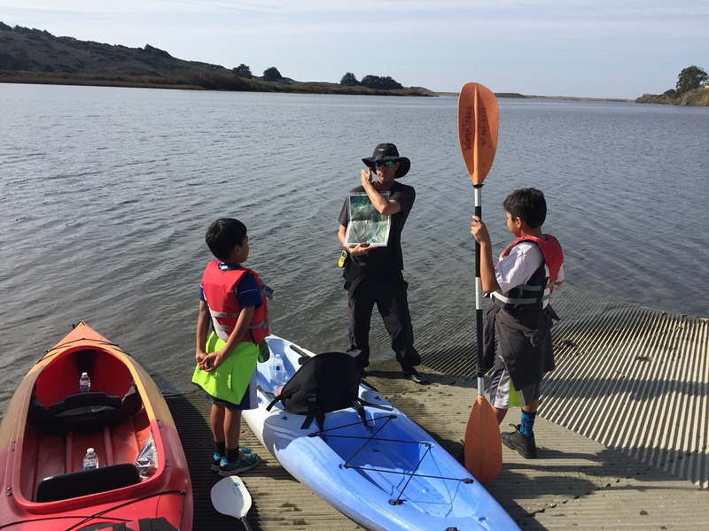 02- Chad instructing Thomas and Joseph on boating and wildlife saftey
