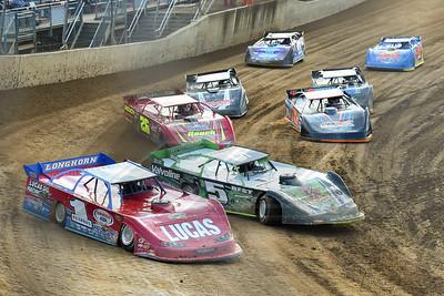 Earl Pearson, Jr. (1) leads a race into turn one