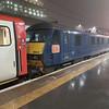 90034 awaits departure at Kings Cross on a Leeds or Newark N.Gate service.