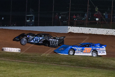 Scott Bloomquist loosing a wheel after taking the lead with 9 laps to go
