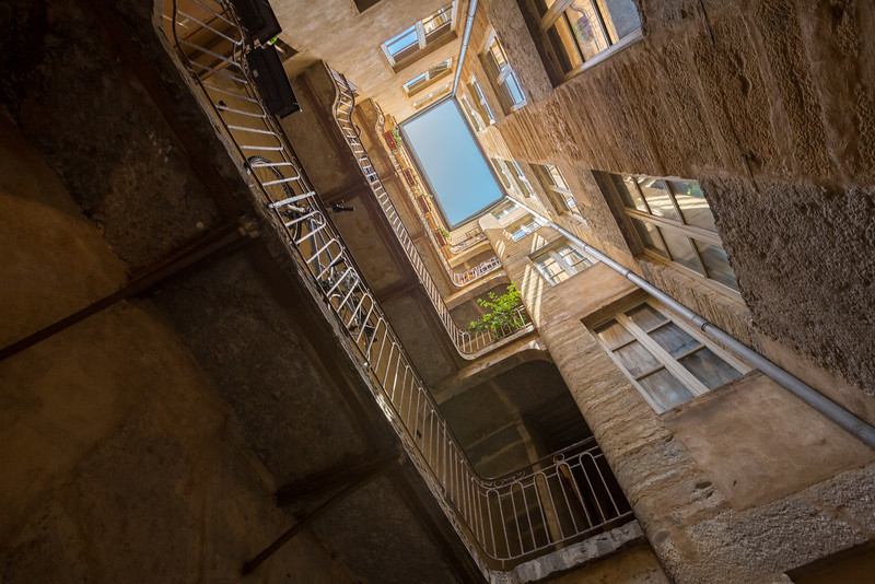 HDR of a skyward view from inside a Traboule