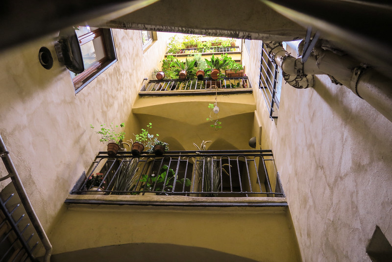 Balconies viewed from the bottom of a Traboule, a passageway that links streets in Lyon