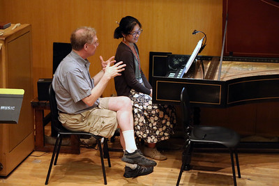 "Pictured here is the class ""Harpsichord Technique,"" taught by MEMF faculty John Chappell Stowe (pictured left)"
