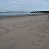 Giant beach writing