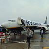 Passengers disembark from the Boeing 737-800 forming the 06:40 London Luton to Dublin Ryanair flight at Dublin Airport.