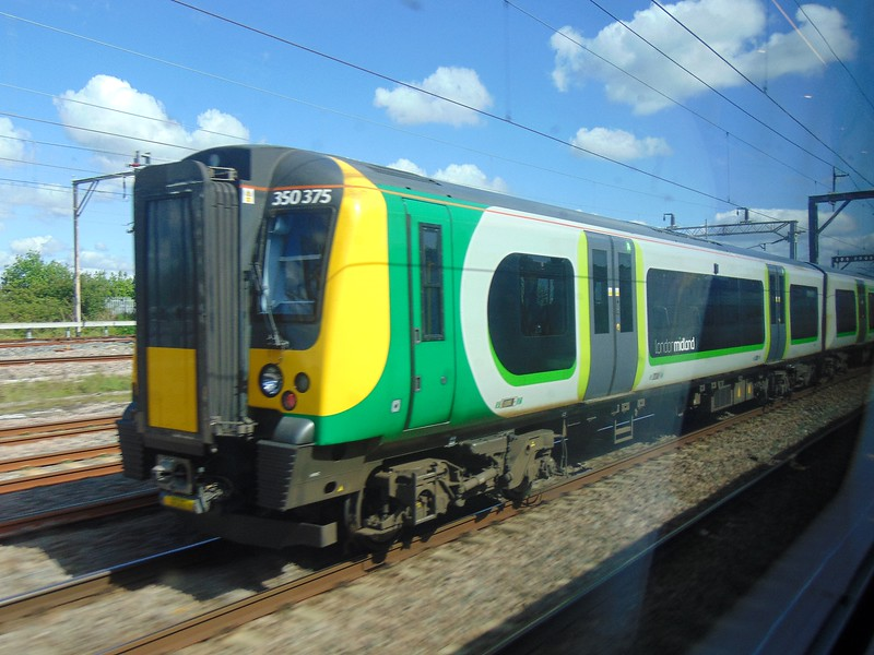Racing London Midland Class 350 Desiro no. 350375 past Bletchley on a Pendolino.