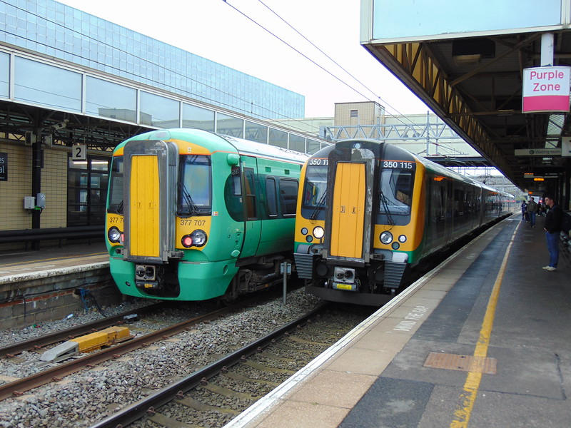 London Midland Class 350 Desiro no. 350115 on a service to Birmingham passes Southern Class 377 Electrostar no. 377707 at Milton Keynes Central.