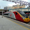 Virgin Trains Class 390 Pendolino no. 390106 leaving Birmingham New Street on a service to Stafford.