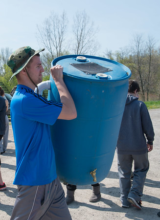 JOED VIERA/STAFF PHOTOGRAPHER-Olcott, NY-Ethan Morgan delivers a rain drum to Singer Farms.