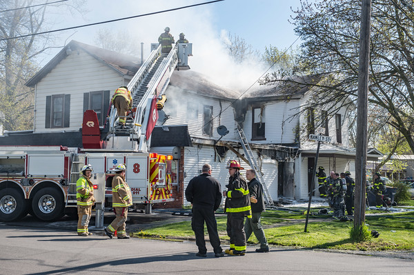 JOED VIERA/STAFF PHOTOGRAPHER-Lockport, NY-Firefighters work at the scene of a fire on Green Street.