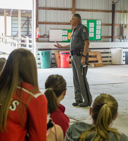 JOED VIERA/STAFF PHOTOGRAPHER-Lockport, NY-New York State Trooper Chris Pyc warns students about the dangers of driving under the influence and while intoxicated during the safety fair at the Niagara County Fairgrounds.