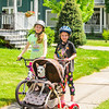 JOED VIERA/STAFF PHOTOGRAPHER-Lockport, NY-Bailey Brewer 11 rides her bike down High Street while Riley Sidor 11 strolls Buster while on a hover board.