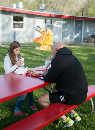 JOED VIERA/STAFF PHOTOGRAPHER-Lockport, NY-Jon Erwin and his daughter Laena, 9, took advantage of the weather and rode their bikes a mile to eat at the recently re-opened Widewaters.