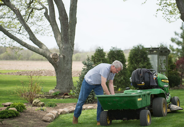 JOED VIERA/STAFF PHOTOGRAPHER-Pendleton, NY- Tom Homme works on his garden.