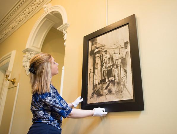 JOED VIERA/STAFF PHOTOGRAPHER-Lockport, NY- Alyssa Neglia straightens a painting at the Kenan House.