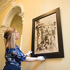 JOED VIERA/STAFF PHOTOGRAPHER-Lockport, NY- Alyssa Neglia straightens a painting at the Kenan House.