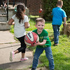 JOED VIERA/STAFF PHOTOGRAPHER-Lockport, NY- Kayden Edwards, 5, Cristian Perez, 5 and Ben Perez play with a Basketball in front of a Outwater Drive lawn.