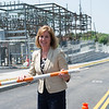 JOED VIERA/STAFF PHOTOGRAPHER-Lockport, NY-Lockport Mayor Anne McCaffrey takes down the last barrier officially re-opening LaGrange to drivers.