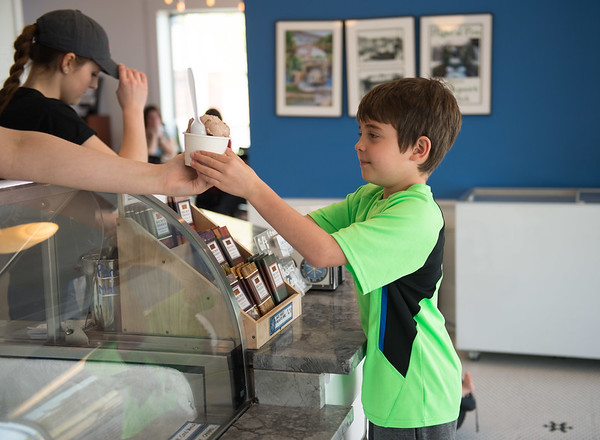 JOED VIERA/STAFF PHOTOGRAPHER-Lockport, NY- James Madan, 8 picks up a frosty treat at Lake Effect Ice Cream.