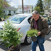 JOED VIERA/STAFF PHOTOGRAPHER-Newfane, NY-Don Zubris moves a few potted plants into his car.