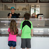 JOED VIERA/STAFF PHOTOGRAPHER-Lockport, NY- Lucy, 6 and James Madan, 8 sample some treats at Lake Effect Ice Cream.