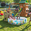 JOED VIERA/STAFF PHOTOGRAPHER-Lockport, NY-A group of kids cool off in a pool on the lawn of a Corinthia Street home.