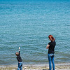 JOED VIERA/STAFF PHOTOGRAPHER-Olcott, NY-Amber Kasperek teaches hers son Jayden 3 to skip stones on Lake Ontario at Olcott Beach.