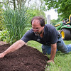 JOED VIERA/STAFF PHOTOGRAPHER-Lockport, NY-Rich Klee tends to one of  DeSales' gardens. Klee has been on school's maintenance staff for 13 years.