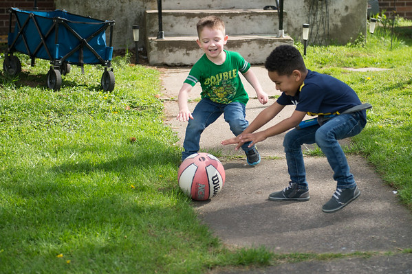 JOED VIERA/STAFF PHOTOGRAPHER-Lockport, NY- Cristian Perez, 5 and  Romere Purville, 5, play with a Basketball in front of a Outwater Drive lawn.