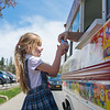 JOED VIERA/STAFF PHOTOGRAPHER-Pendelton, NY- DeSales first grader Lauren Zglinicki 6 grabs an oreo bar from Chilly Billy's Ice Cream Truck.