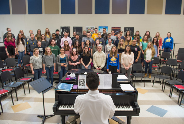 JOED VIERA/STAFF PHOTOGRAPHER-Lockport, NY- Rob Pacillo leads students that will be joining choir alumni in a special end of year concertduring a rehearsal at Lockport High School.