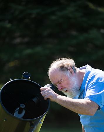 JOED VIERA/STAFF PHOTOGRAPHER-Wilson, NY- Steve Smith looks through his telescope .