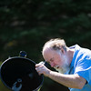 JOED VIERA/STAFF PHOTOGRAPHER-Wilson, NY- Steve Smith looks through his telescope .