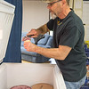 JOED VIERA/STAFF PHOTOGRAPHER-Pendelton, NY- Terry Krentz owner of  Uncle G's Ice Cream scoops up a cone. Krents' ice cream stand has been opened for 13 years.
