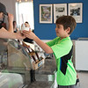 JOED VIERA/STAFF PHOTOGRAPHER-Lockport, NY- James Madan, 8 picks up a frosty treat at Lake Effect Ice Cream.