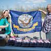 JOED VIERA/STAFF PHOTOGRAPHER-Pendleton, NY-Dan Gafus of the Pendleton Veterans Association sells a flag to Anne Miller. The Association is selling flags to raise money for a monument.