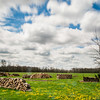 JOED VIERA/STAFF PHOTOGRAPHER-Wilson, NY-Clouds pass over a fire wood filled field on Maple Road.