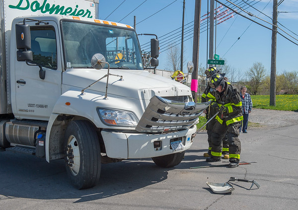 JOED VIERA/STAFF PHOTOGRAPHER-Lockport, NY- Firefighters work at the scene of an accident on Heath Street close to West Ave.