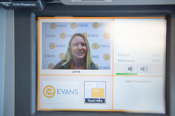 JOED VIERA/STAFF PHOTOGRAPHER-Lockport, NY- Jamie talks to a customer through the ITM machine at Evans Bank.
